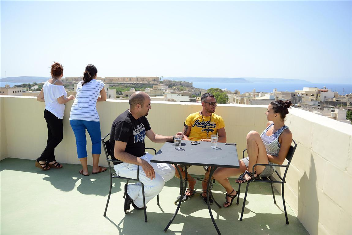 IELS Gozo accommodation - Migiarro Residence - students on the roof