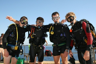 A group of excited scuba divers